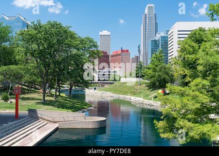 City Skyline in Downtown Omaha, Nebraska along the Gene Leahy Mall - Stock Photo