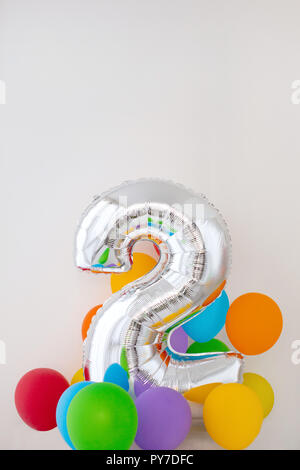 Number 2 two of color balloon on light background - Stock Photo