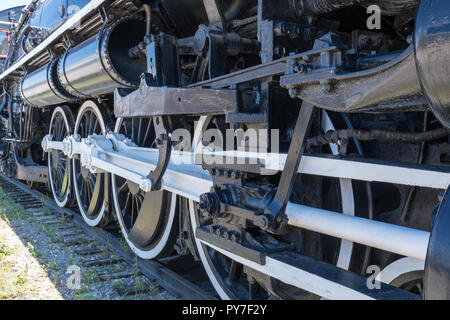 Iron Wheels of Old Steam Railroad Locomotive - Stock Photo