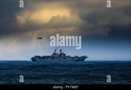 US Navy amphibious assault ship USS Iwo Jima, part of a NATO task force, sails near Iceland October 23, 2018 carrying elements of 45 Commando Royal Marines and US Marines traveling to NATO exercise Trident Juncture 2018. With around 50,000 participants from 31 nations, Trident Juncture 2018 is one of NATO's largest exercises in recent years. Around 250 aircraft, 65 ships and more than 10,000 vehicles are involved in the exercise. Photo: PO(Phot) Jim Gibson, Royal Navy Reserve - Stock Photo