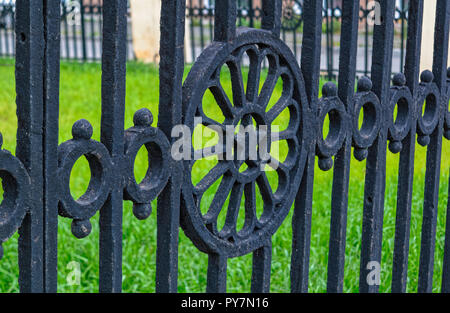 Fragment of an old cast-iron fence - Stock Photo
