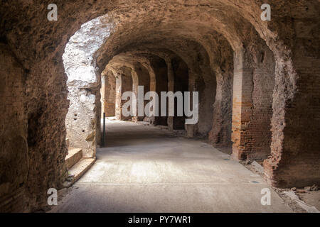 To let your imagination go, it is nice to walk in the arched area around the Amphitheatre of Capua in the Italian region of Campania. - Stock Photo