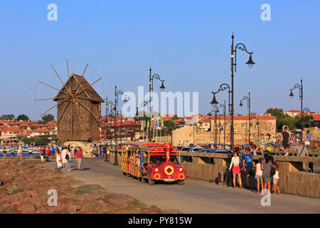 The wooden windmill on the isthmus leading to the ancient city walls and Northern harbor in Nesebar, Bulgaria - Stock Photo