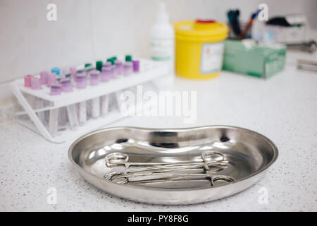 medical instruments in the tray, disposable gloves on the table. health, longevity, - Stock Photo