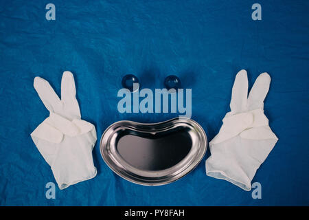 medical tray, disposable gloves showing the peace sign, jars for taking biomaterial lined in the form of a smiling face. health, longevity, - Stock Photo
