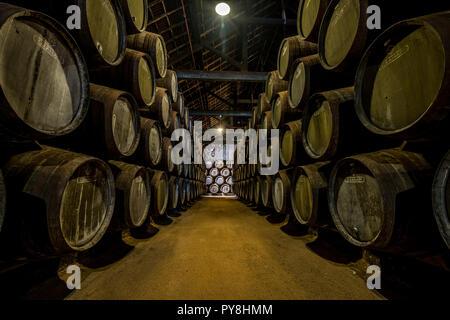 PORTO, PORTUGAL - June 19, 2018: Port wine barrels in Graham's port lodge, Vila Nova de Gaia, Porto, Portugal - Stock Photo