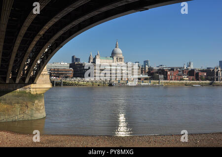 North bank and St Paul's Cathedral from under the arch of Blackfriar's railway station bridge, London, England, UK - Stock Photo