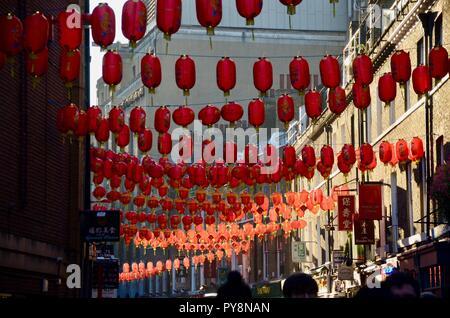 red lanterns hanging over lisle street in chinatown soho london UK - Stock Photo