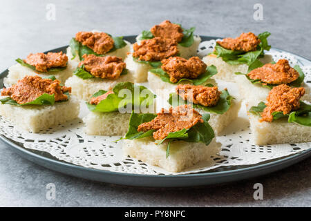 Canape with Muhammara, Adjika, Ajika or Acuka on Small Square Breads with Round Plate. Traditional Organic Appetizer. - Stock Photo