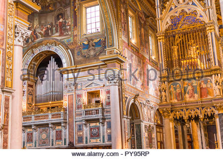 Altar and intricate wall decoration of Archbasilica of St. John Lateran, a Papal major basilica. Rome. Italy. - Stock Photo