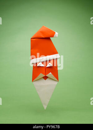 A  PAPER SANTA CLAUS MADE USING THE ART OF ORIGAMI - Stock Photo