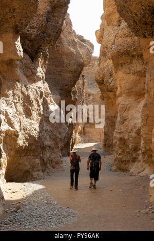 Namibia tourism - tourists walking in the Sesriem Canyon, Namib desert, Namib-Naukluft national park near Sossusvlei, Namibia Africa - Stock Photo