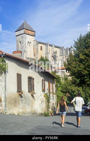 Tourists visiting the village Saint-Bertrand-de-Comminges, Haute-Garonne, Pyrenees, France - Stock Photo