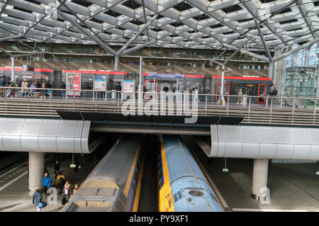 Tram And Trains Inside The Central Station At Den Haag The Netherlands 2018 - Stock Photo