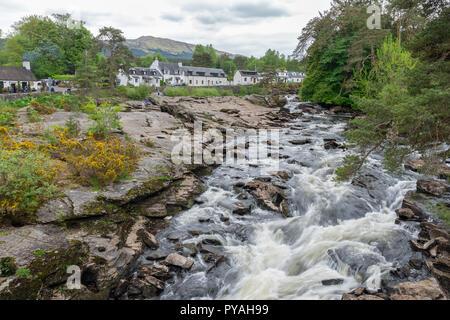 Falls of Dochart near Killin in Scottish Highlands, long exposure - Stock Photo