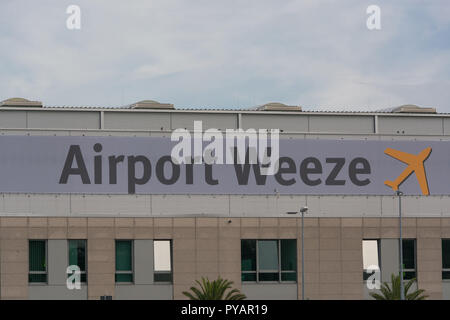 Entrance area of regional airport Weeze photographed from the parking lot - Stock Photo