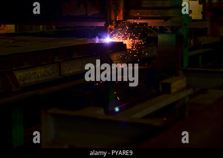Plasma cutting. Industrial plasma machine cutting of metal plate.  Laser equipment management and plant manufacturing metal structures and machines - Stock Photo