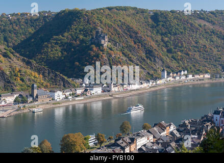 Rhineland towns of St Goarshausen on left bank and St Goar on right bank in autumn - Stock Photo