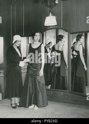 Ladies fashion in the 1930s. Pictured to the left  Grand Duchess Maria Pavlovna of Russia (1890–1958). She became interested in design and made business with Coco Chanel. She established herself as a fashiondesigner in America and her she presents an evening gown of her own design on Dec 17 1930. - Stock Photo