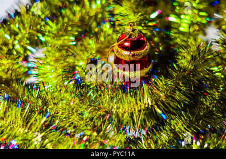 Decorated Christmas tree on blurred, sparkling and fairy elegant abstract background with bokeh lights and stars. Glowing abstract black and purple ab - Stock Photo