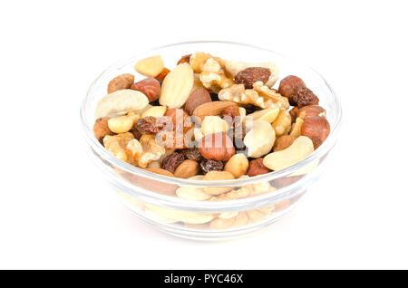 Student food in glass bowl. Student fodder. Snack mix of dried almonds, cashews, peanuts, walnuts, hazelnuts and raisins. Trail mix. - Stock Photo