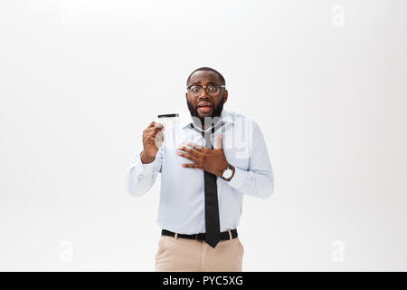 Afro american man holding credit card over isolated background scared in shock with a surprise face, afraid and excited with fear expression. - Stock Photo