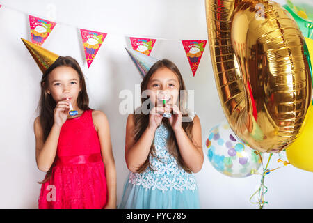 Group of kids celebrate birthday party together - Stock Photo