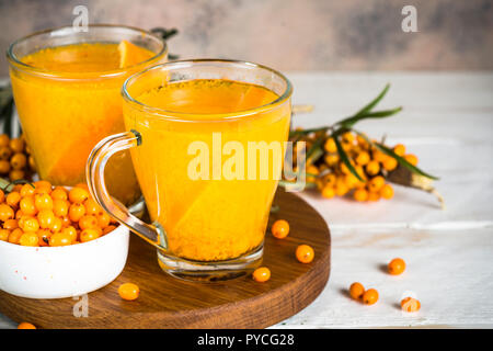 Sea buckthorn tea with orange in a glass cups. - Stock Photo