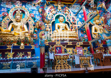 Bylakuppe, Karnataka, India - January 9, 2015: 18 meters high statues inside the Golden Temple - Padmasmbhava, the Buddha and Amitayus. Namdroling Nyi - Stock Photo