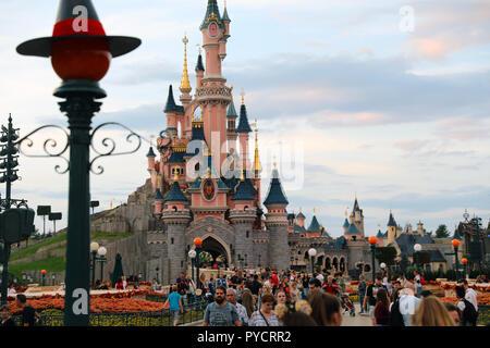 Marne-la-Vallée, France - October 14, 2018: Sunset At  Sleeping Beauty Castle In Disneyland Paris (Euro Disney), Crowd Of People, Marne-la-Vallée, à - Stock Photo