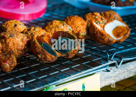 Black egg or century egg, pidan, a preserved egg on food market in Thailand - Stock Photo