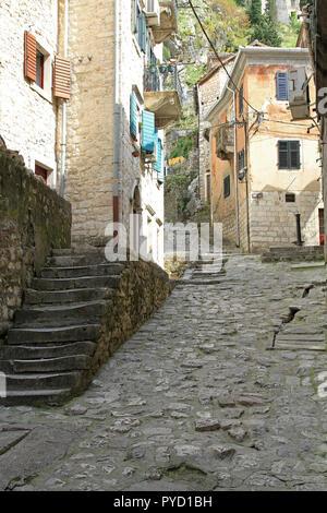 Old cobblestone streets of Kotor in Montenegro - Stock Photo
