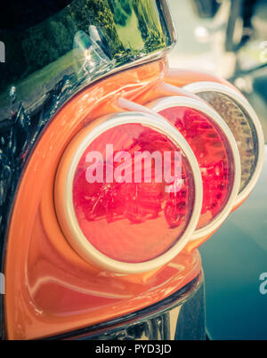 back view tail light of a customized motorcycle, switzerland - Stock Photo