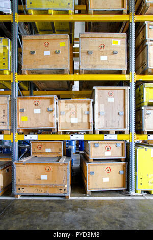 Transportation crates at shelf in museum warehouse - Stock Photo
