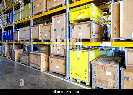 Rugged crates at shelves in museum warehouse - Stock Photo