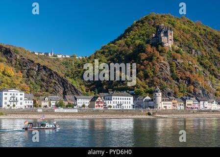 Katz castle overlooking Rhine town of St Goarshausen in autumn, Germany - Stock Photo