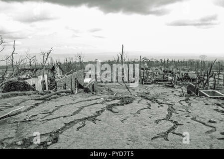 The aftermath of the volcanic eruption of Mount Merapi in 2010 on the village of Pakem close to Merapi in Java Indonesia - Stock Photo