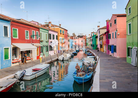 Burano, Italy - October 2018: The colorful fishermen's houses in Burano on a clear morning - Stock Photo