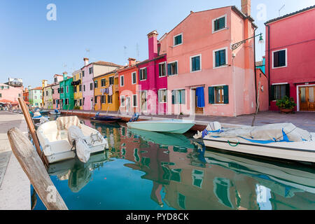Burano, Italy - October 2018: The colorful fishermen's houses in Burano on a clear day - Stock Photo