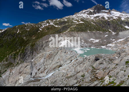 Lake at the end of the Rhône Glacier and The source of the River Rhône on the Furka Pass, Switzerland. - Stock Photo