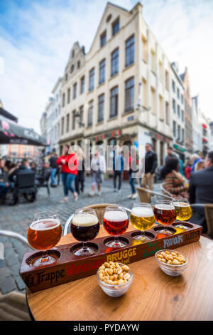 Tasting various beer on wooden plate in Brusseles - Stock Photo