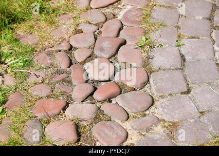paving stones at the porch of the house. Power bricks are arranged in a circular pattern of concentric geometric circles. Architectural background wit - Stock Photo