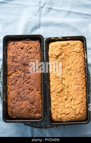 Freshly baked loaves of bread. Potato and oat & cranberry bread. - Stock Photo