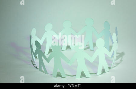 business background.team paper men standing holding hands. - Stock Photo