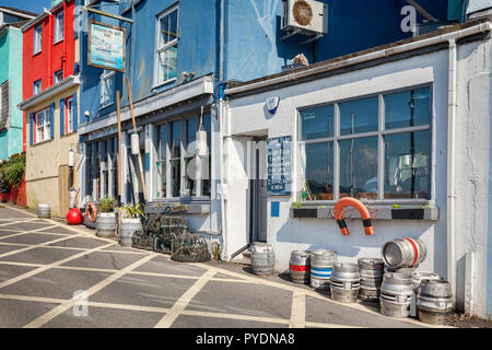 23 May 2018: Kingswear, Devon, UK - The Steam Packet Inn in Fore Street, where it overlooks the River Dart. - Stock Photo