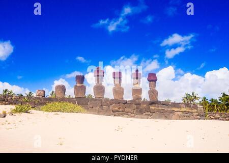Moais of Ahu Nau Nau in Anakena beach in Easter Island, Chile Rapa Nui - Stock Photo
