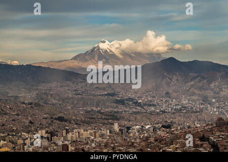 Panoramic cityscape in La Paz in Bolivia. High snow mountain in the back - Stock Photo