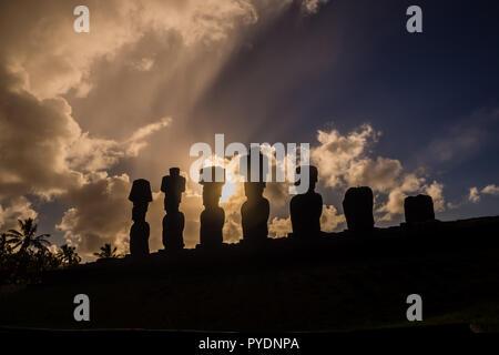 Silhouette of the moais of Ahu Nau Nau in Easter Island. Anakena Beach in Rapanui, Chile - Stock Photo