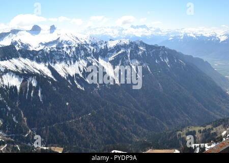 View from Les Rochers de Naye, reached by MOB train from Montreux. To west is Lake Geneva, Lausanne. To east famous peaks including Eiger, Monch etc - Stock Photo
