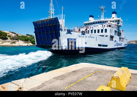 Sardinia, Italy, 06-09-2018: Summer landscape with the ferry boat colored in white and blue travelling from palau, sardinia to La Maddalena Archipel. - Stock Photo